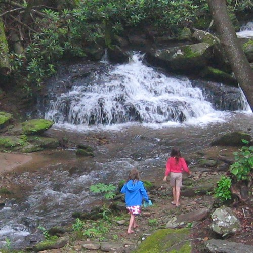 Children enjoying the Laughing Waters waterfall