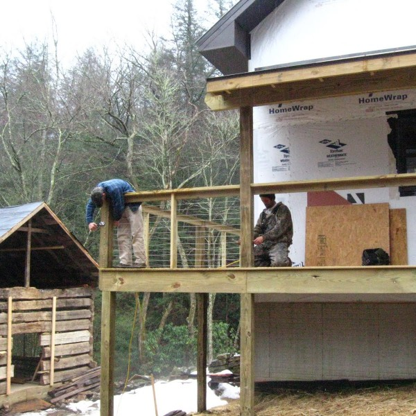 Old log cabin added at site of old gristmill ruins