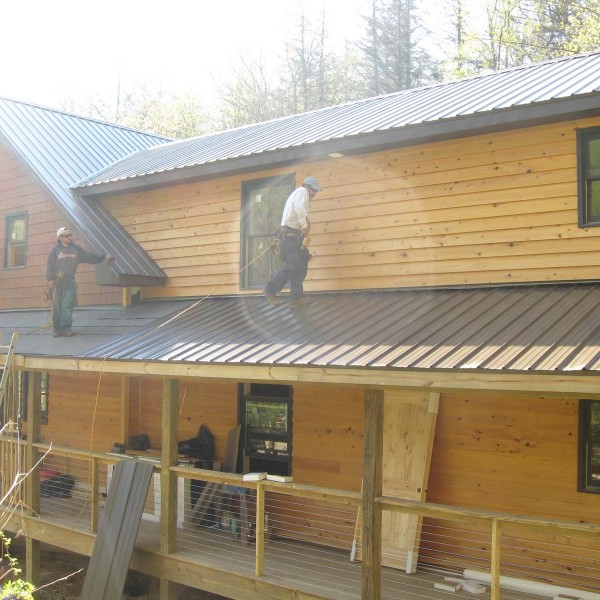 Cypress siding and metal roofing