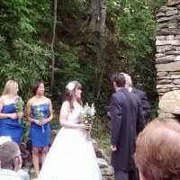 wedding ceremony by the old stone chimney at Laughing Waters