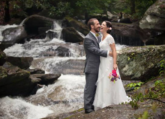 Bride and groom by the Laughing Waters waterfall
