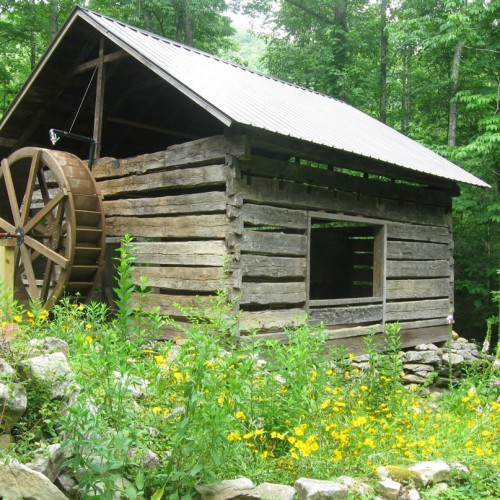 waterwheel on 1840s log cabin at Hickory Nut Forest